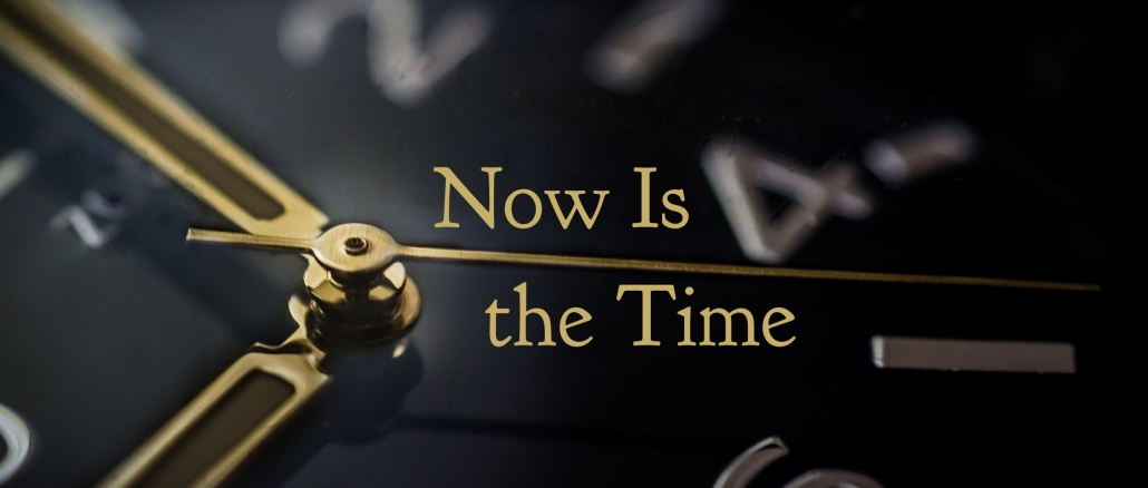 "Clock. Gold on black. Text added: ""Now is the Time."""