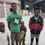 Alexander Prices two older children, Zayvion and Elijah, shown here with two younger brothers, are now old enough to participate in Full Circle 360. Credit: Alexander Price
