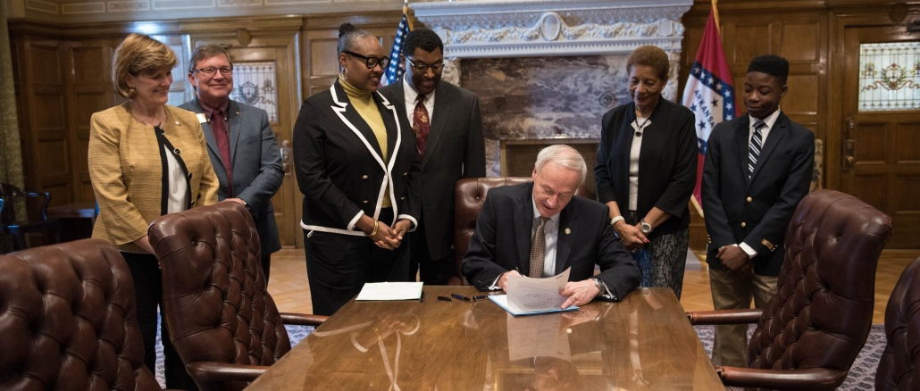 Arkansas Act 451 ceremonial signing on March 31, 2017. Credit: Governor's office. Arkansas Governor Asa Hutchinson signs Act 451, thus designating the Delta portion of U.S. Highway 65 as the Delta Rhythm & Bayous Highway. This is one key step in the heritage tourism plan developed by the Delta Rhythm & Bayous Alliance. Credit: Arkansas Governor's Office / governor's office photographer