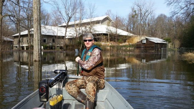 Eric Maynard navigating flood waters at the Delta Rivers Nature Center. Credit: Brett Crow