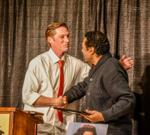 Brian Austin, iconic Blues musician from the Delta, presents Bobby Rush a plaque and lifetime membership to the Port City Blues Society. Credit: Cindy Tutt Scaife Photography