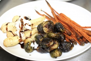 The third course is added to platters. Brussel sprouts and other veggies. See Front Porch Hospitality Group - Chef's inaugural dinner menu. Credit: Charity Stephens